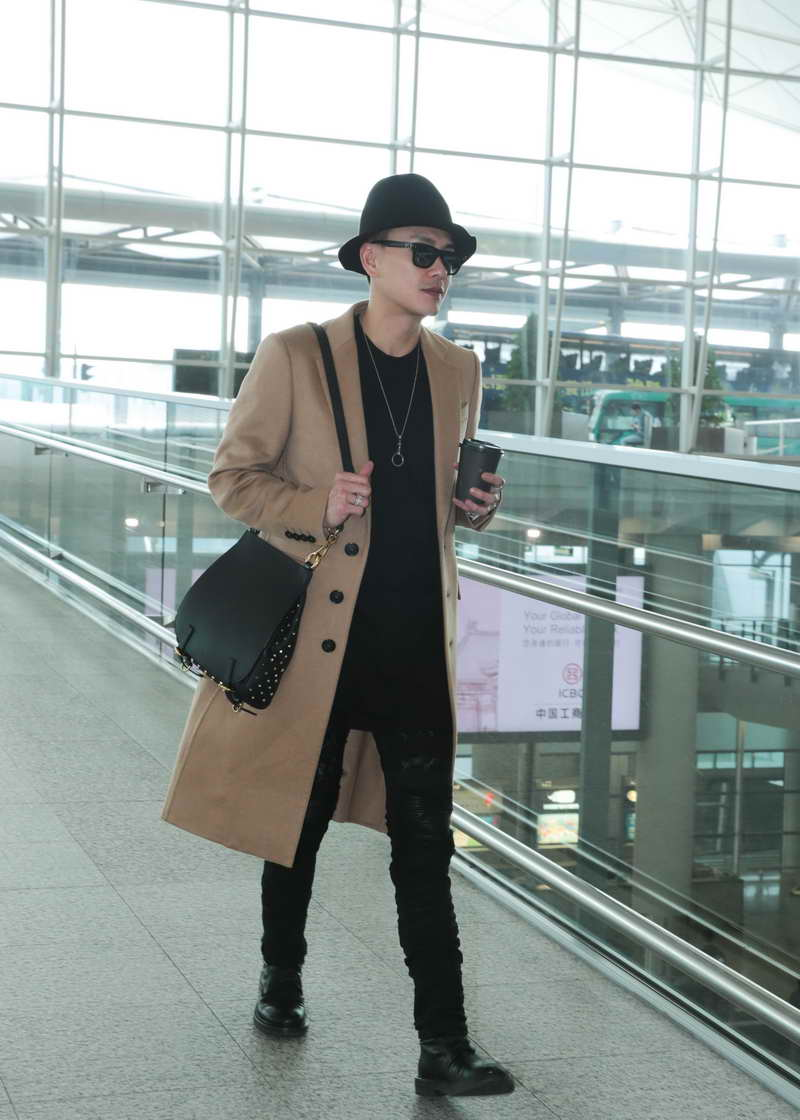 Bosco Wong wearing Burberry cashmere coat and The Bridle at Hong Kong International Airport on 21st November 2016