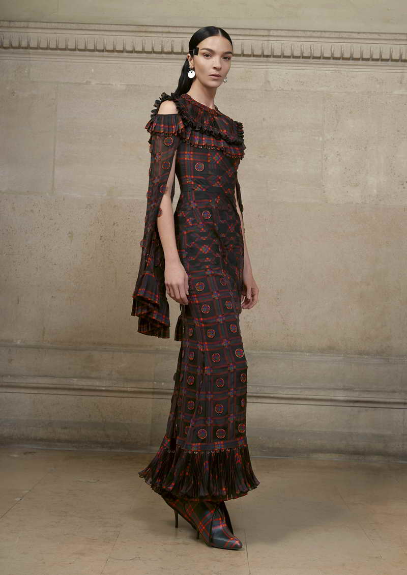 MARIACARLA Long dress in silk chiffon printed with a red tartan pattern, hand pleated at the neck, cuffs and hem and embellished with thin metal disks covered with chiffon. + printed jersey jumpsuit and lace incrusted