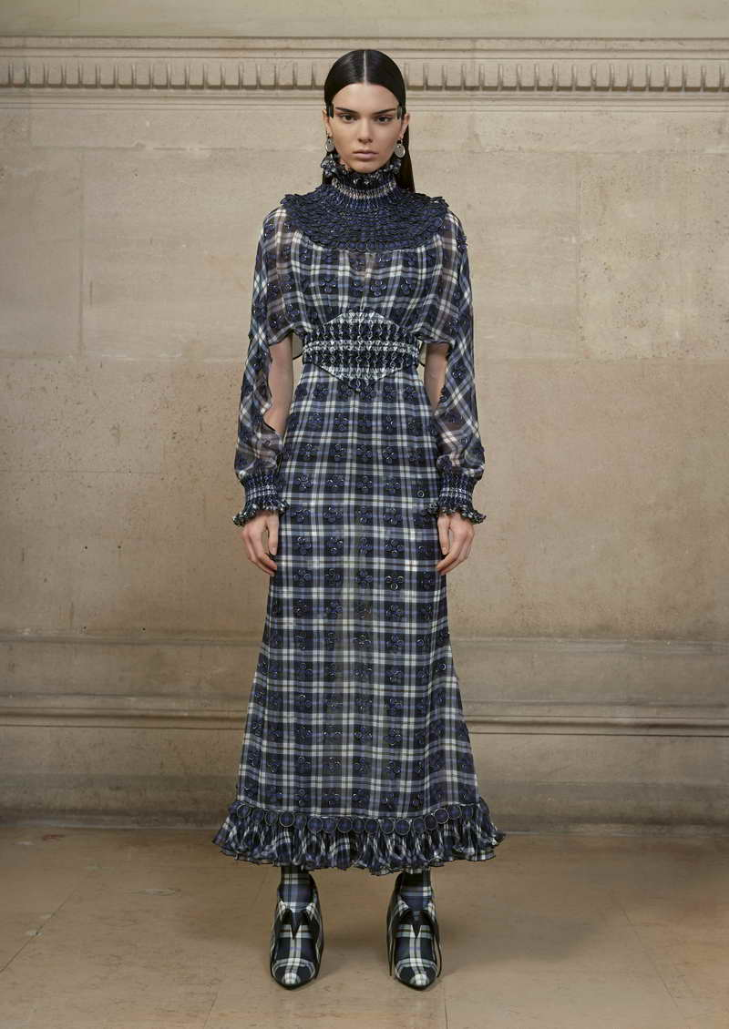 KENDALL Long dress in silk chiffon printed with a blue and black tartan pattern, hand smoked at the neck, waist and wrists and embellished all over with small graduated metal disks covered with chiffon. + printed jersey jumpsuit and lace incrusted