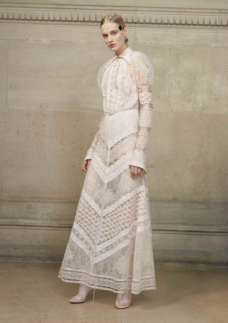 SUNNIVA Long dress made entirely of a mix of Chantilly lace, bands of lace and embellished lace, with sleeves decorated with feather on the inside, in bands of lace with small metal rings appliqué. + jumpsuit in patchwork of lace stripes
