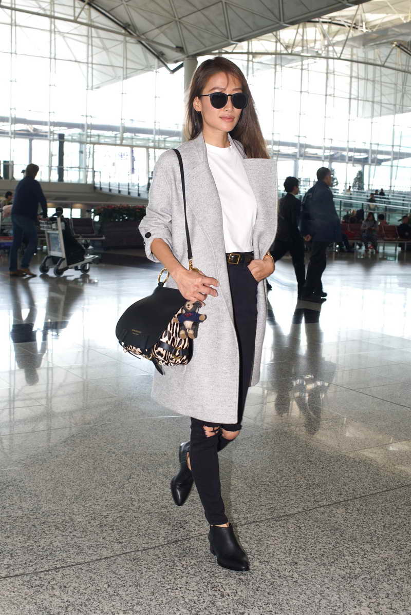 Jennifer Tse wearing Burberry Cashmere coat and The Bridle at Hong Kong International Airport on 17th November 2016