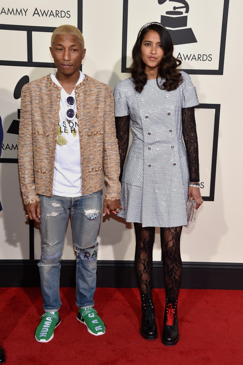 LOS ANGELES, CA - FEBRUARY 15:  Recording artist Pharrell Williams (L) and Helen Lasichanh attend The 58th GRAMMY Awards at Staples Center on February 15, 2016 in Los Angeles, California.  (Photo by John Shearer/WireImage)