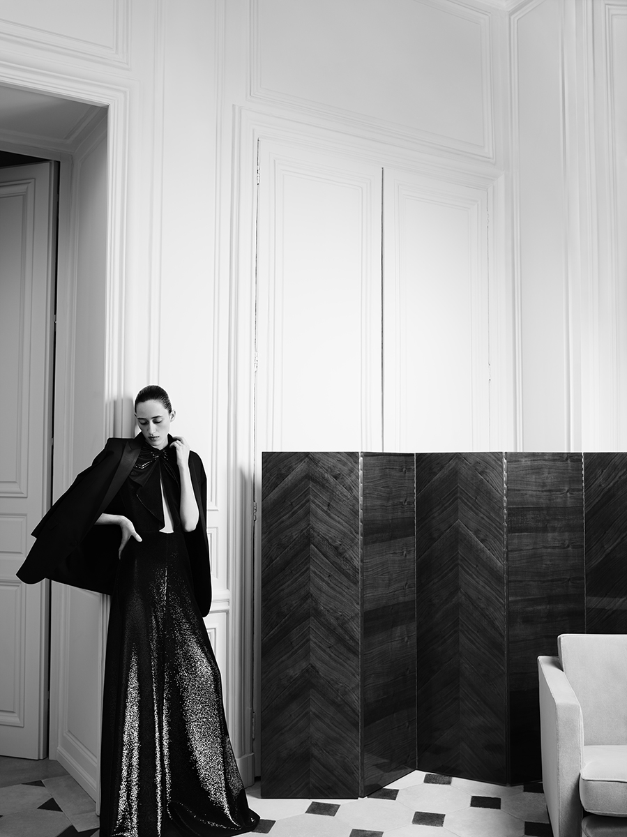 "Saint Laurent girl Helena in a sequined couture black evening gown / ""Le Salon Blanc"""
