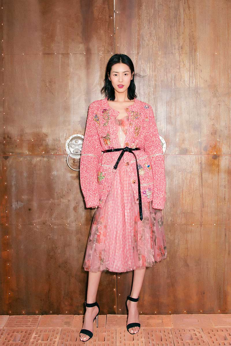 Wearing a SS18 mouliné knitted cardigan with heirloom brooch embroidery, pleated glass organza gingham & floral print corset dress, black patent leather belt and heart sandals by Alexander McQueen in Beijing, 24th March, 2018.