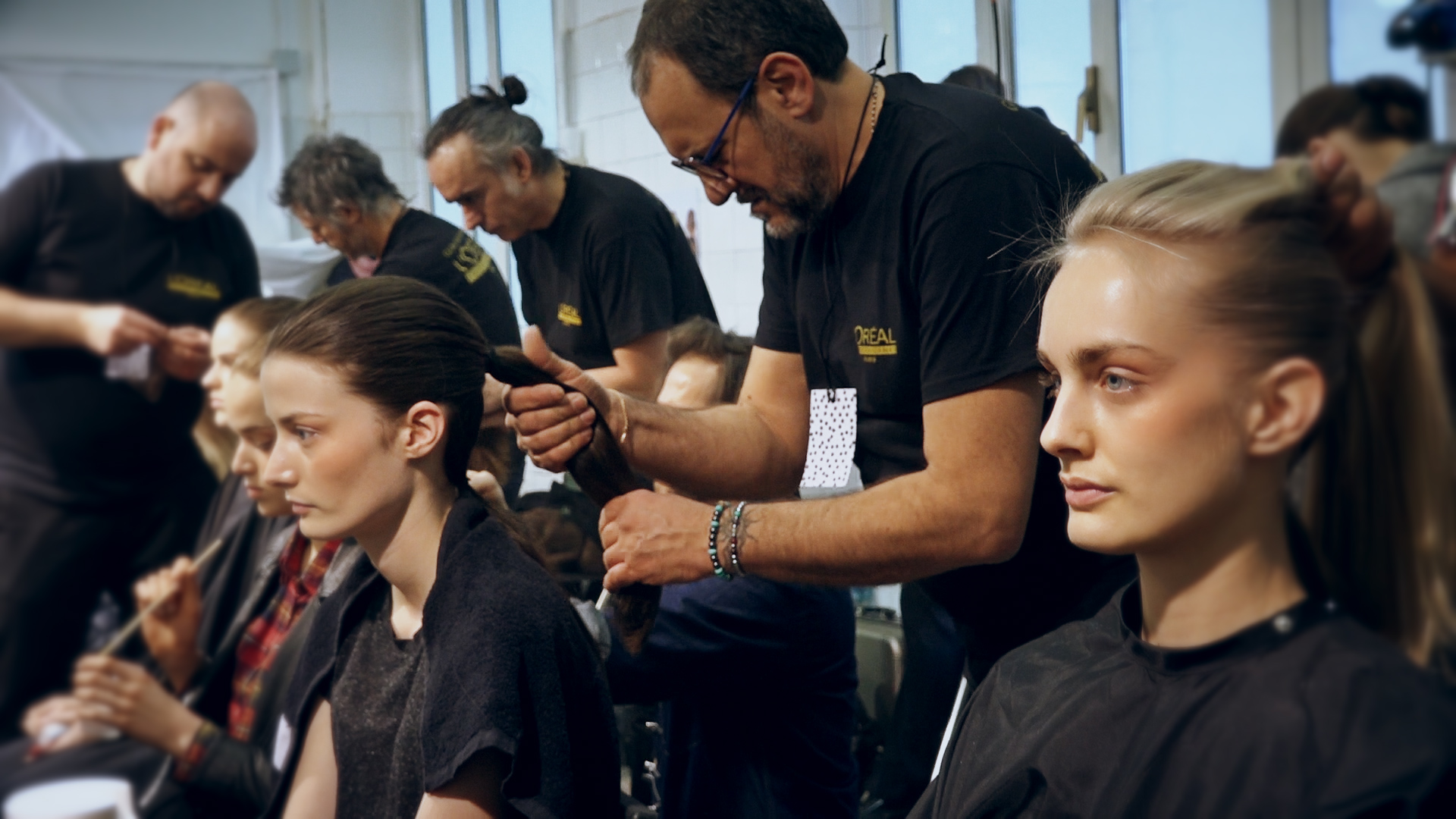 Hair styles: two pony tails to create an elegant chignon with Peter Grey